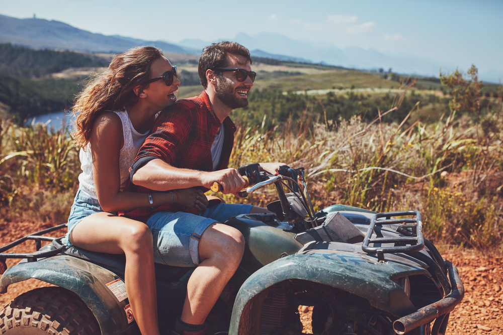 couple driving atv in one of the best getaways in texas